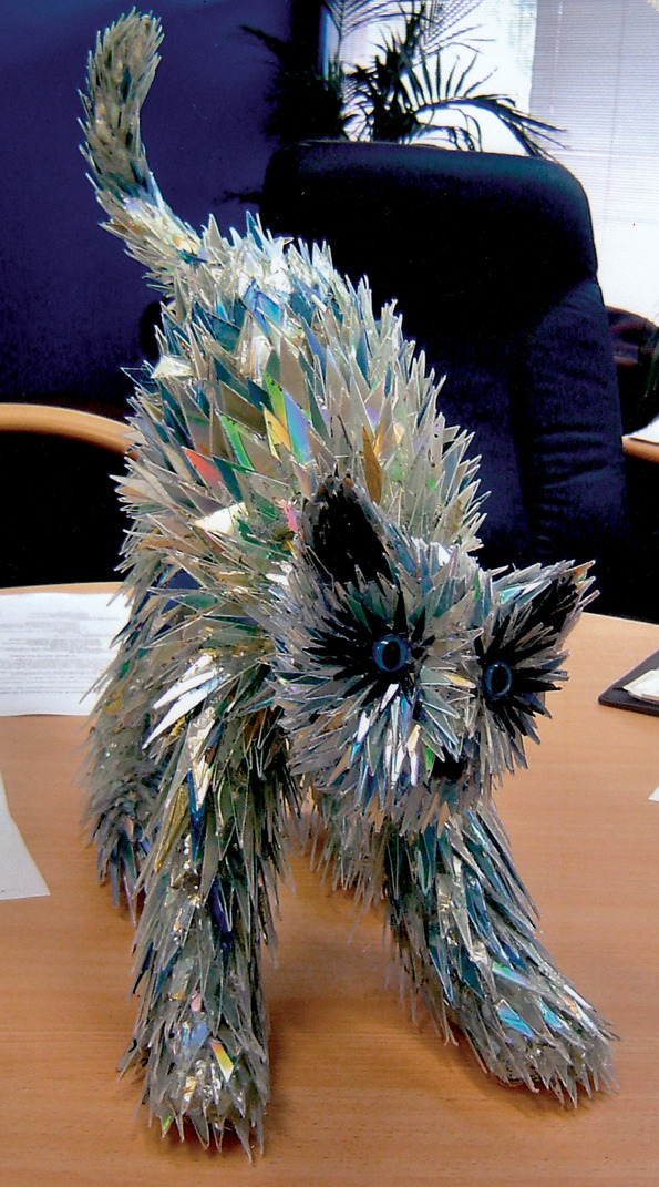 Broken cds transformed into iridescent animal sculptures for Cool things to make out of recycled materials